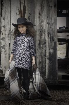 Girls dresses ar either multi-ruffled and wide and swinging or slimmer shift shapes at How to Kiss a Frog for winter 2014