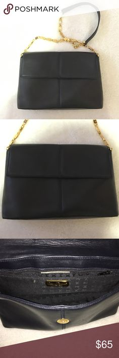 Paloma Picasso purse Authentic. Vey good condition. Black leather. Gold chain strap. Zipper picked inside. Magnetic fold over snap to close bag. Paloma Picasso Bags Mini Bags