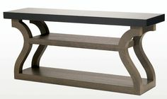 """christian liaigre console - """"I particularly like this console because of its curved, half-circle legs. Its form shows how creatively wood can be used, and gives a sexy twist to a soft, cool, and contemporary design."""""""