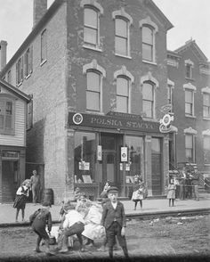STREET PLAY: A Polish neighborhood in Chicago, 1903.