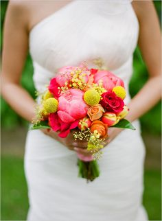 Peony wedding bouquet for the modern bride looking for pops of color. This bouquet is sweet and innocent, yet playful. The Peonies look so delicious; they almost look like cotton candy. The vibrant hues of yellow, coral and hot pink blend nicely together; making this an ideal bouquet for a summer wedding. Flowers: Peonies, Craspedias, Tulips, Roses, Ranunculuses, Mimosas and foliage