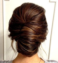 Smooth French twist updo on brown hair #WeddingHairstylesForLongHair