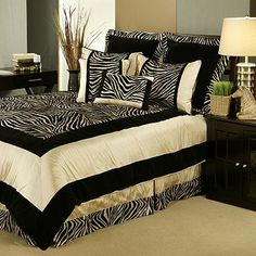 Go wild with your bedroom decor with this zebra print comforter set that features black and taupe colors and soft and velvety fabrics. Set includes comforter, bed skirt, 2 shams, boudoir pillow, and 2 square pillows. Zebra Print Bedroom, Zebra Bedding, Taupe Bedding, Zebra Bedrooms, Queen Comforter Sets, Bedding Sets, California King, Beddinge, African Home Decor