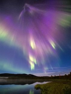 """New Aurora Pictures: Solar Flare Sparks """"Snakes,"""" """"Spears"""" – Lisa Martin New Aurora Pictures: Solar Flare Sparks """"Snakes,"""" """"Spears"""" A supernova-like burst of mostly purple auroras lights up Finnish countryside in a wide-angle sky shot. Beautiful Sky, Beautiful World, Beautiful Places, Ciel Nocturne, Archangel Gabriel, To Infinity And Beyond, Science And Nature, Belle Photo, Amazing Nature"""