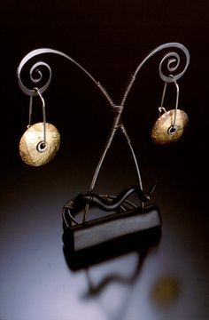 Celie Fago, earrings on interesting display stand
