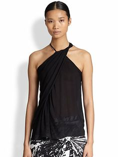 Twisted front neck and side bodice.  High back neck with zipper opening.  Asymmetrical racerback and hem.