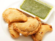 Vegan Smoky Potato And Caper Empanadas With Cilantro Garlic Lime Sauce - Will convert sauce to dressing (with addition of a little vinegar, oil and maybe ginger, peanut butter, soy sauce and agave)