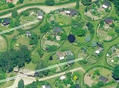 Nærum Allotment Gardens in Denmark, are considered one of C. Th. Sørensen's most important creations. In 1948 40 oval allotment gardens, each measuring c.25 × 15 m/80 × 50 ft, were laid out on a rolling lawn, a common green, in a fluid progression.