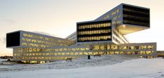 Overlooking a fjord on the outskirts of Oslo, Statoil's new regional office at Fornebu is one flexible, inspiring and innovative meeting and workplace for 2,500 employees. The building by the Norwegian architecture firm A-Lab offers a daring study in modular design. The prefab project comprises five identical volumes that suggest stacked horizontal skyscrapers—crisscrossing and boldly cantilevered to create overhangs of up to 100 feet.
