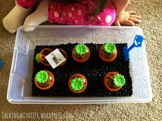 "Spring gardening sensory bin! Digging up carrots in ""dirt"" (beans). Read more on the blog! #SLPA #speechtherapy #springactivities #toddler #totschool #carrots #dollartree #99centstore #thrifty"