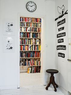 I don't know if I would like so many white rooms but I like the colorful books and that right wall