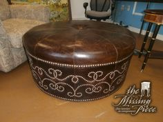 Giardini leather ottoman from Lexington featuring distinctive nailhead accenting around the brown upholstered aniline leather. Measures 40*40*19. Retails currently for $1150.