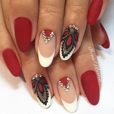 Ignite the flame of passion within with this red baroque nail art. Sultry red, black and white come together to create a highly-decorative, formal design.