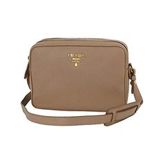 8188304f22 This handbag can be worn over the shoulder or as a cross body with the  adjustable strap. Includes authenticity cards and Prada dust-bag.