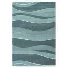Hand-tufted wool rug with a tonal wave motif.   Product: RugConstruction Material: WoolColor: MultiFeatures: Contemporary style Note: Please be aware that actual colors may vary from those shown on your screen. Accent rugs may also not show the entire pattern that the corresponding area rugs have.Cleaning and Care: Blot spills and stains immediately. Professional cleaning recommended