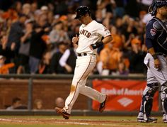 San Francisco Giants' Tyler Colvin (10) scores off of a single by San Francisco Giants' Brandon Hicks (14) against the Atlanta Braves in the seventh inning at ATT Park in San Francisco, Calif. on Monday, May 12, 2014. (Nhat V. Meyer/Bay Area News Group)
