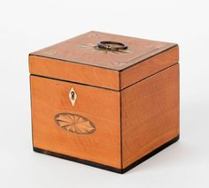 Federal satinwood tea caddy, ca. 1800, with paterae inlays.