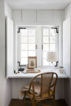 minimalist office space; wicker, white, & rustic black window hardware