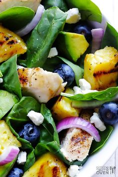 Grilled Pineapple, Chicken and Avocado Ingredients:     2 boneless skinless chicken breasts     2 tsp. olive oil     salt and pepper     1 fresh pineapple, peeled, cored and sliced into 1-inch thick rings     8 cups baby spinach     1 cup fresh blueberries     1 avocado, peeled, pitted and diced     1/2 cup crumbled feta cheese     quarter of a red onion, thinly sliced     honey garlic vinaigrette