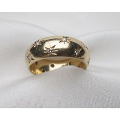 Circa 1950. This is a beautiful mid century fine estate 14KT yellow gold wide wedding band, sparkling with (16) sixteen diamonds in starburst bead settings. The sparkling single cut diamonds have a .32 carat total weight, VS2 clarity and G-H color.