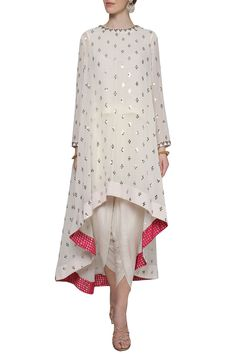 Vvani by Vani Vats Featuring an off white asymmetrical kurta in georgette base embellished with sequin hand embroidery and brocade inline borders. It is paired with dhoti pants in crepe base.Costumised similar dress for order HOUSE OF ZUHAF Pakistani Dress Design, Pakistani Outfits, Indian Outfits, Pakistani Fashion Casual, Dress Indian Style, Indian Dresses, Indian Wear, Kurta Designs Women, Blouse Designs