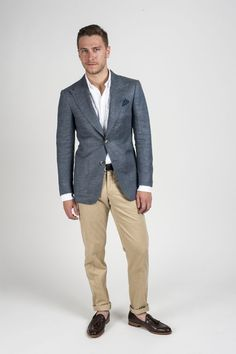 Shop this look for $193: http://lookastic.com/men/looks/dress-shirt-and-chinos-and-tassel-loafers-and-pocket-square-and-blazer-and-belt/727 — White Dress Shirt — Khaki Chinos — Brown Leather Tassel Loafers — Navy and White Polka Dot Pocket Square — Charcoal Blazer — Dark Brown Leather Belt