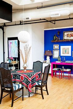 Modern Bohemian Loft by Design Manifest - Situated in Philadelphia, this eclectic loft space was decorated by Design Manifest with a mix of neutrals, metallics and bright blues and pinks.