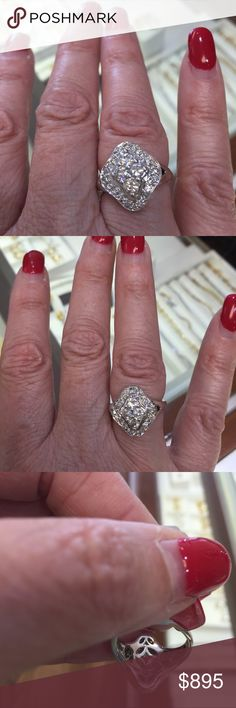 Sparkling diamond cluster ring! Beautiful diamond cluster ring with 28 diamonds totaling .72 carat and appx 5.5 grams of white gold. Definitely an eye catcher. Jewelry Rings