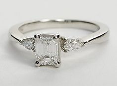 I would want a longer emerald cut diamond for this though. Graceful and enduring, this diamond engagement ring showcases two brilliant pear-shaped side diamonds set in platinum to intensify sparkle. Setting includes 1/4 carat total diamond weight.