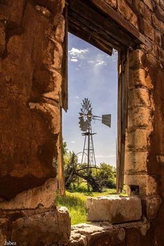 Windmill with pump, framed Farm Windmill, Old Windmills, Wind Of Change, Country Scenes, Farms Living, Window View, Through The Window, Old Farm, Le Moulin