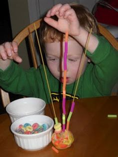 gave the kids an assortment of items to string on their spaghetti.  We used small bowls of penne, Cheerios, Fruit Loops, and cut up straws.