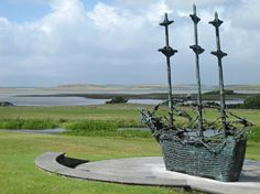 Coffin Ship National Memorial, County Mayo, Ireland whose rigging is skeletons - commemorating the 1845-52 Irish famine when millions died or fled and 30% of those on the ships lie in the sea. Ireland's largest bronze, unveiled in 1997.