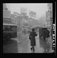 """March 1943 """"New York, New York. Times Square on a rainy day"""" Photographer John Vachon"""