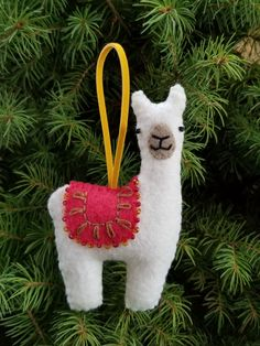 This adorable llama ornament has a lovely red blanket that has been carefully beaded and embroidered. This llama comes in a range of colours! Felt Christmas Decorations, Felt Christmas Ornaments, Christmas Fun, Diy Ornaments, Beaded Ornaments, Homemade Christmas, Glass Ornaments, Llama Decor, Felt Crafts Patterns