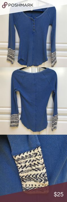 Free People Henley Alpine Thermal Knit Cuff Blue Never worn! A stylish take on the classic thermal top that features soft sweater knit cuffs in an alpine design that elevate the cuff of this slim-fitting Henley tee. Antiqued brass buttons. Rounded hem. 57% Cotton 38% Polyester & 5% Spandex. Free People Tops Tees - Long Sleeve