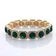 Gold and Emerald Green Crystal Rhinestone Stretch Bracelet TrinketCentral. $24.95. Easy wear with stretch design.. Intense dark green crystals.. Very fashionable for evening attire.. Beautiful color contrast of gold and green.. Save 38%!