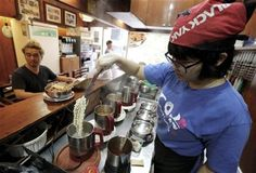 """In this Aug. 19. 2014 photo, a cook prepares """"ramyeon"""" instant noodles for Han Seung-youn, left, during an interview at a ramyeon restaurant in Seoul, South Korea. (AP Photo/Ahn Young-joon ) ▼21Aug2014AP Noodles: Friend or foe? S. Koreans defend diet http://bigstory.ap.org/article/noodles-friend-or-foe-s-koreans-defend-diet #instant_noodles #Seoul #ramyeon"""