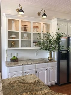 Kitchen Cabinet Sconce Light. Cabinets and shiplap wall in kitchen is Benjamin Moore OC-17 White Dove.  Kitchen Cabinet Sconce Light Ideas. Kitchen Cabinet Sconce Light. #Kitchen #Cabinet #SconceLight Beautiful Homes of Instagram @cindimc.ivoryhome