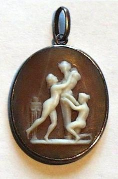 This rare erotic cameo depicts a satyr in dalliance with two nymphs and is probably inspired by a work by the sculptor Canova.  It is a pendant and might have been used as a decorative charm on a man's watch chain or might have adorned a courtesan's neck.  It has been executed by a master hand; the carving is delicate and the figures are graceful and well-proportioned. The frame is in silver.  The cameo has a unnoticeable old restoration.  Date: ca 1770 - 1800.  Origin: France     Appraisal…