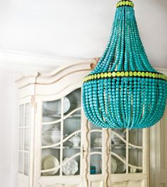Chandelier idea - light hanging inside with translucent beads