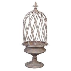 This decorative planter is designed with a crisscross caging and a fleur-de-lis finial that will bring a classic elegant vibe in your space. It is made of iron with a weathered and oxidized finish for a charming rustic look. The sturdy iron metal construction and the flattened traditional pedestal base of this planter make it perfect for both indoor and outdoor setting. Color: Beige. Square Planters, Decorative Planters, Metal Planters, Garden Planters, Birdcage Planter, Birdcage Decor, Carpenter Bee Trap, Bee Traps, Gardens