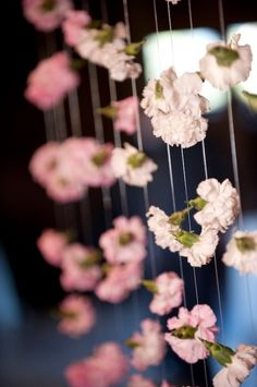 Carnations attached to ribbons streaming from the  vow tree