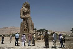 Unveiling: Tourists and experts gather around the newly displayed statue of Amenhotep III in Luxor