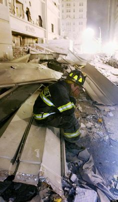 A fireman holds his face in his hands in the debris of the World Trade Center. | Shared by LION