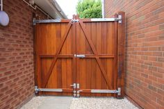 """Double gates produced in Western Red Cedar from our """"Brentwood"""" collection. Rear view showing structural bracing, gate hinges, brenton bolt and drop bolts."""