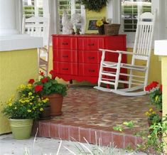 could not be more in love with this red dresser on daisy cottage's front porch