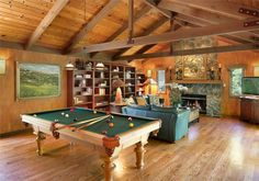 Bonus Room: Exposed wood beams and stone fireplace give this entertainment/game room a warm, rustic feel.
