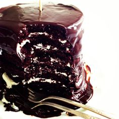 Vanilla Cream-Filled Cake for Two via Sweetapolita\\Moist, dark and decadent chocolate chip devil's food cake stacked high and filled with vanilla cream and covered in a rich and super chocolatey glaze . . . for 2.