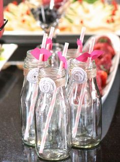 Lips for straws!  Spa theme birthday party - frappuccino bottles with vintage straws and lip straw flags