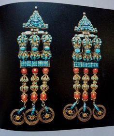 "Official's ornaments from Tibet. Made of gold, silver, gilt iron, turquoise, lapis lazuli, and coral. As much as 21.7 cm high; width is 5.5 cm. Shown by Jane Casey Singer, in *Gold Jewelry from Tibet and Nepal* (1996), p. 107. (Successful ""officials"" are wealthy in many societies at many times in history! Also, their jewellery was seen as an appropriate sign of their status, in traditional Tibetan life. - JD)"